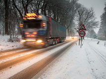 Fast moving heavy goods vehicle in a snow storm Royalty Free Stock Photo