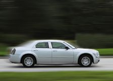 Fast moving luxury car Stock Image