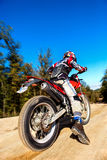 Fast moving motocross rider on dirt road. Royalty Free Stock Photography