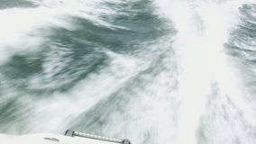 Fast Moving motor boat. And wake trail with splashes on the water behind stock video footage