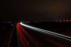 Fast Moving Motor Cars On The Motorway At Night. Stock Photos