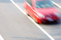 Fast moving red car Stock Photography