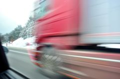 Fast moving red truck Royalty Free Stock Photography