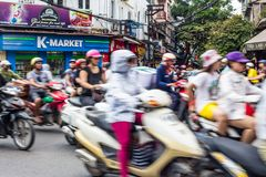 Fast moving scooters in downtown of Hanoi, Vietnam stock image
