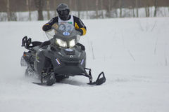 Fast moving snowmobile rider stock images
