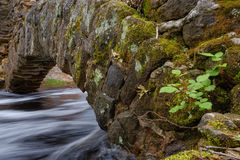 Free Fast Moving Stream Flows Under A Historic Stone Arch Royalty Free Stock Images - 40537209