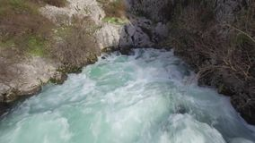 A fast-moving stream of the mountain river. In Montenegro stock footage