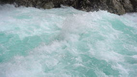 A fast-moving stream of the mountain river stock video footage