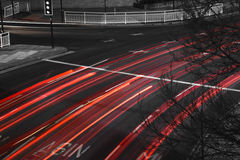 Fast Moving Traffic with red light trails on black road Stock Photography