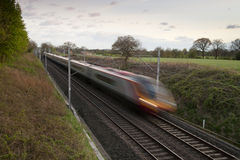 Fast moving train Stock Images