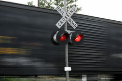 Fast moving train. At a railroad crossing Royalty Free Stock Photography