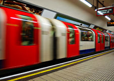 Fast moving train. Fast moving underground train leaving a station Royalty Free Stock Photography
