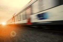 Fast moving train at dawn Stock Image