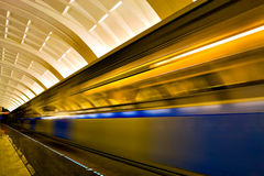 Fast moving train by motion Royalty Free Stock Photography