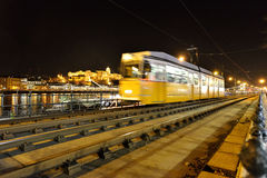 Fast moving tram in Budapest. The tram network of Budapest is part of the mass transit system of Budapest, the capital city of Hungary. The tram lines serve as Stock Photography
