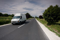 Fast moving van. In a road Stock Images