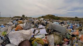 A variety of rubbish on piles of garbage in a dump. Fast moving between a variety of garbage on piles of garbage in a dump stock video footage