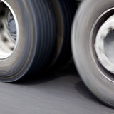 Fast moving vehicle wheels Stock Photos