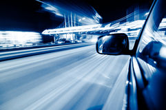 Fast moving vehicles in the city. Filmed in fast cars in the city night landscape Stock Photo