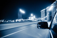 Fast moving vehicles in the city. Filmed in fast cars in the city night landscape Stock Image