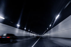Fast moving vehicles in the tunnel. Automotive advertising background picture for road construction Stock Photography
