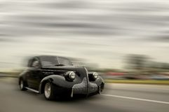 Fast moving vintage car Stock Images
