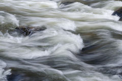 Fast moving water in creek rapids Royalty Free Stock Photography