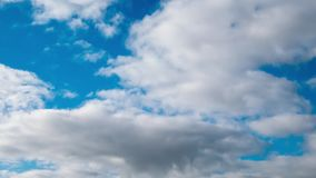 Fast moving white clouds on blue sky, timelapse.  stock footage
