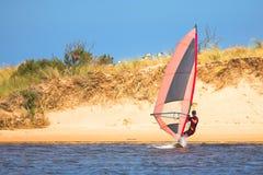 Fast moving windsurfer Stock Photos