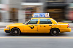 Fast Moving Yellow Cab Stock Photography