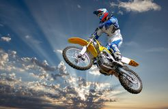The fast pace of a motocross motorcycle. royalty free stock photos