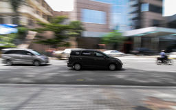 Fast pace. Panning shot on a busy street of Kuala Lumpur Royalty Free Stock Photos