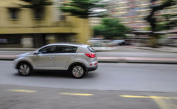 Fast pace. Panning shot on a busy street of Kuala Lumpur Royalty Free Stock Photo