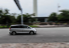 Fast pace. Panning shot on a busy street of Kuala Lumpur Royalty Free Stock Images