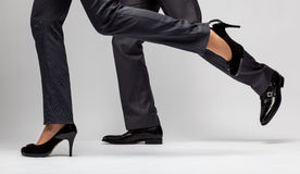 Fast-paced business: male and female legs running Stock Photography