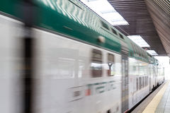 Fast Passenger Commuter Train with Motion Blur Royalty Free Stock Photos