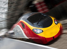 Fast Passenger Speed Train with Motion Blur. Modern Fast Passenger Speed Commuter Train in the Station with Motion Blur. Tilted View Royalty Free Stock Image