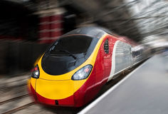 Fast Passenger Speed Train with Motion Blur. Modern Fast Passenger Speed Commuter Train in the Station with Motion Blur Stock Photography