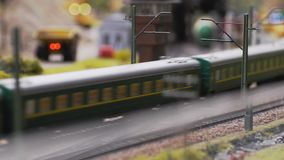 Fast passenger train toy in the countryside moving towards in slow motion. 3840x2160. 4k stock video