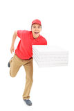 Fast pizza delivery guy running. Isolated on white background Royalty Free Stock Images