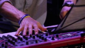 Fast Play Piano Keyboard. Hands red synthesizer at a jazz concert closeup