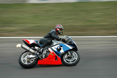 Fast racing bike. A racing motorbike with panning Stock Image