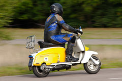 Fast racing scooter Stock Photography