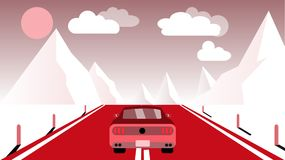 A fast racing sports red car rides a trip to the mountains along the road against the backdrop of pink mountains, sun and clouds. Stock Image