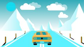 A fast racing sports yellow car rides a trip to the mountains along the road against a background of blue mountains, sun and cloud Royalty Free Stock Photo