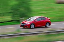 Fast red hatchback Royalty Free Stock Photo