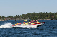 Fast rescue vessel with rescuerunner Royalty Free Stock Image