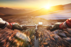 Fast ride. On bike in mountain valley. Sport and active life concept stock photography