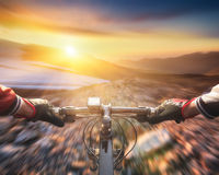 Fast ride on bike. In mountain valley. Sport and active life concept stock photos