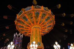 Fast ride on an illuminated chairoplane. With high flying chairs royalty free stock photos